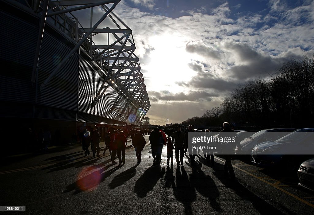 Fans arrive at he stadium prior to kickoff during the Barclays Premier League match between Southampton and Tottenham Hotspur at St Mary's Stadium on December 22, 2013 in Southampton, England.