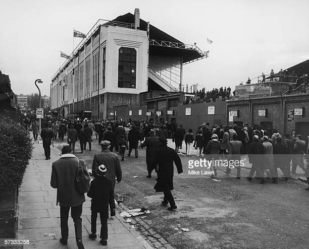 Fans arrive at the Arsenal football ground in Highbury for a match against Everton 1st January 1972