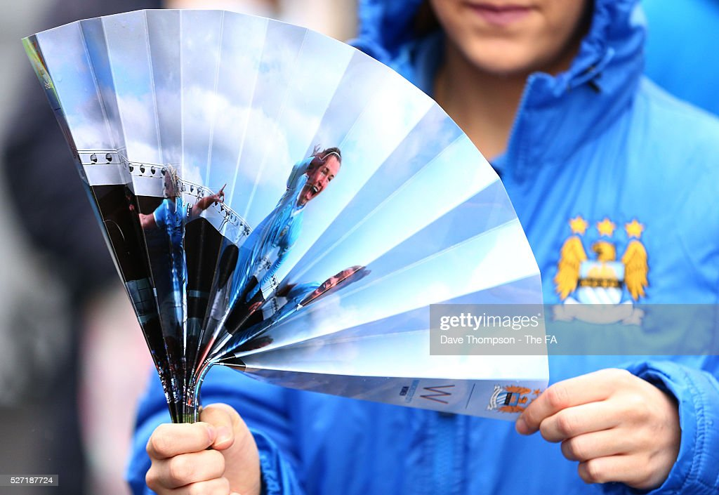 Fans arrive at the ground during the game between Manchester City Women and Doncaster Belles at the Manchester City Academy Stadium on May 2, 2016 in Manchester, England.