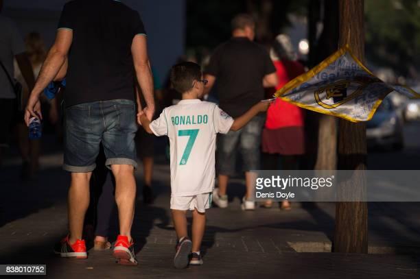 Fans arrive at the Santiago Bernabeu stadium ahead of the Santiago Bernabeu Trophy match between Real Madrid CF and ACF Fiorentina at Estadio...