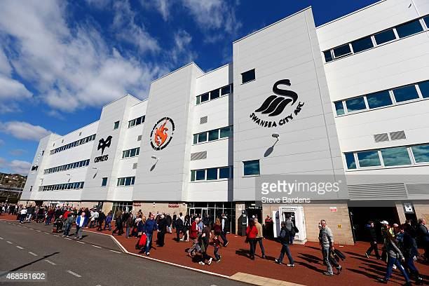 Fans arrive at the stadium before the Barclays Premier League match between Swansea City and Hull City at Liberty Stadium on April 4 2015 in Swansea...