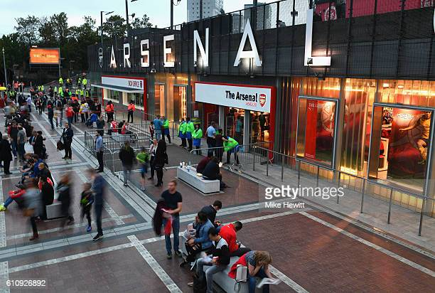 Fans arrive at the stadium before the UEFA Champions League group A match between Arsenal FC and FC Basel 1893 at the Emirates Stadium on September...