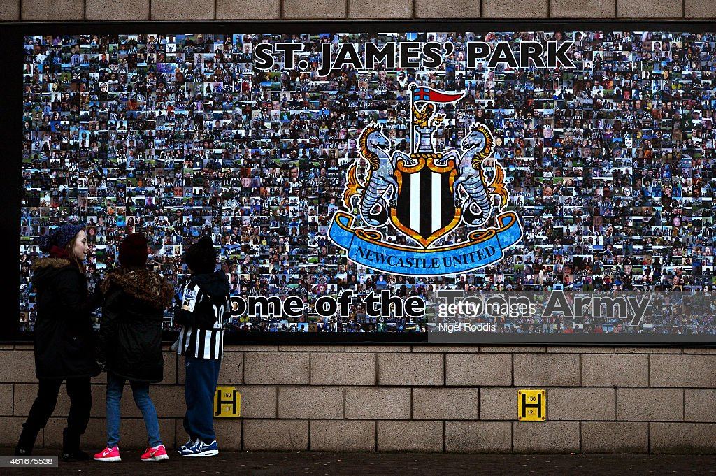 Fans arrive at the stadium for the Barclays Premier League match between Newcastle United and Southampton at St James' Park on January 17 2015 in...