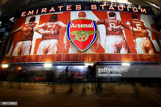Fans arrive at the stadium for the Barclays Premier League match between Arsenal and Leicester City at Emirates Stadium on February 10 2015 in London...