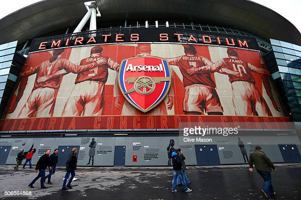 Fans arrive at the stadium for the Barclays Premier League match between Arsenal and Chelsea at Emirates Stadium on January 24 2016 in London England