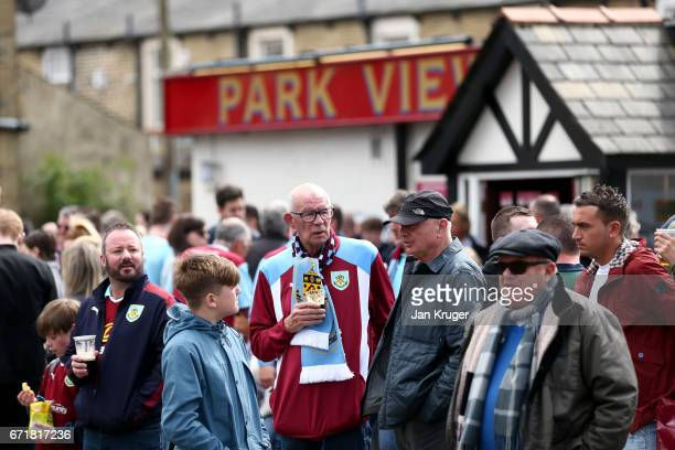 Fans arrive at the stadium for the Premier League match between Burnley and Manchester United at Turf Moor on April 23 2017 in Burnley England