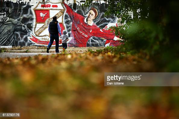 Fans arrive at the stadium for the Sky Bet League One match between Swindon Town and Bolton Wanderers at County Ground on October 8 2016 in Swindon...