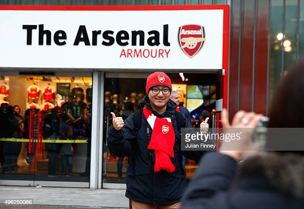 Fans arrive at the stadium prior to kickoff during the Barclays Premier League match between Arsenal and Tottenham Hotspur at the Emirates Stadium on...