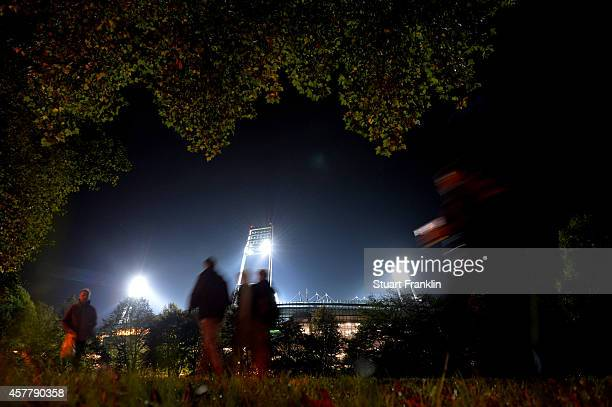 Fans arrive at the stadium prior to kickoff during the Bundesliga match between SV Werder Bremen and FC Koeln at Weserstadion on October 24 2014 in...