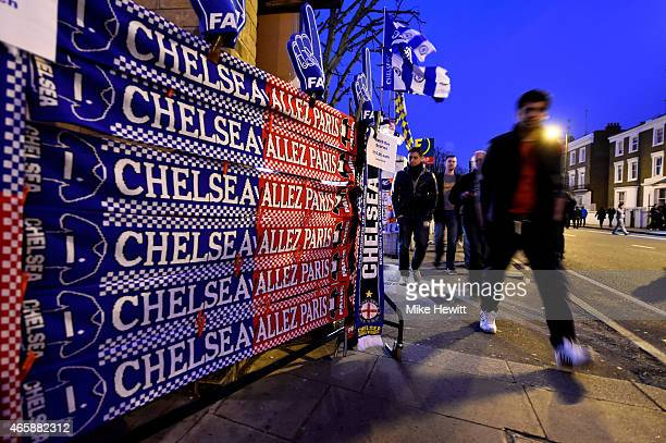 Fans arrive at the stadium prior to kickoff during the UEFA Champions League Round of 16 second leg match between Chelsea and Paris SaintGermain at...
