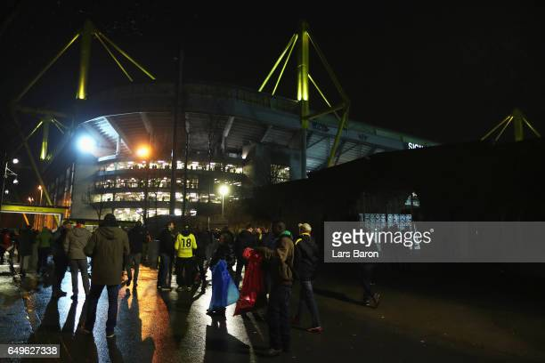 Fans arrive at the stadium prior to the UEFA Champions League Round of 16 second leg match between Borussia Dortmund and SL Benfica at Signal Iduna...