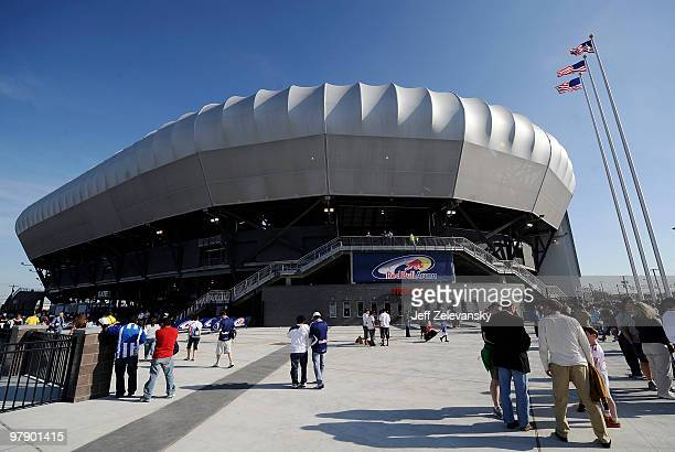 Fans arrive before a match between the New York Red Bulls and Santos FC for the first match to be played at Red Bull Arena on March 20 2010 in...