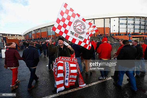 Fans arrive before the Scottish League Cup SemiFinal match between Dundee United and Aberdeen at Hampden Park on January 31 2015 in Glasgow Scotland