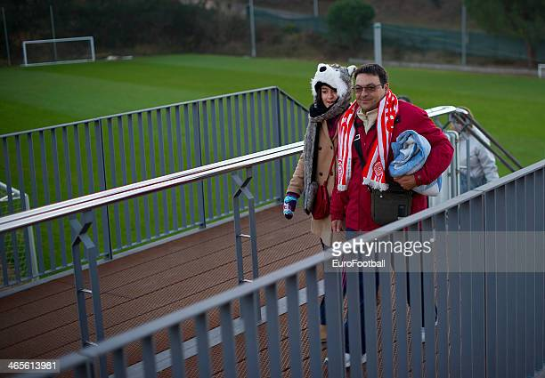 Fans arrive before the Spanish Segunda Division match between Girona FC and SD Eibar at the Estadia Montilivi on January 25 2014 in GironaSpain