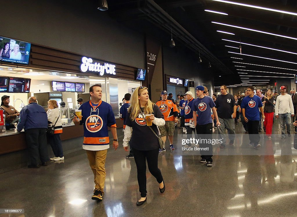Fans arrive for a preseason game between the New York Islanders and the New Jersey Devils at the Barclays Center on September 21, 2013 in Brooklyn borough of New York City.The game is the first professional hockey match to be held in the arena that is slated to be the new home for the Islanders at the start of the 2015-2016 season.