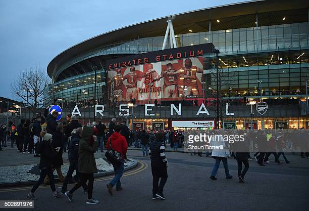 Fans arrive for the Barclays Premier League match between Arsenal and AFC Bournemouth at Emirates Stadium on December 28 2015 in London England