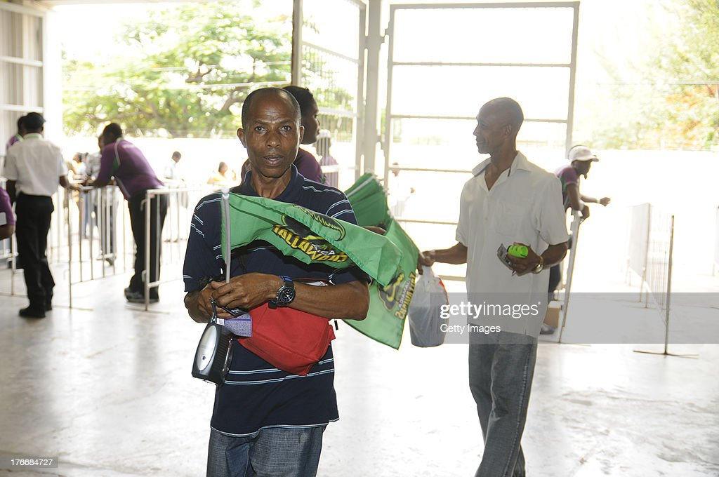 Fans arrive for the Cricket Caribbean Premier League between St. Lucia Zouks v Trinidad and Tobago Red Steel at Sabina Park on August 17, 2013 in Kingston, Jamaica.