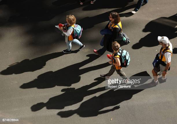 Fans arrive for the round six AFL match between the Hawthorn Hawks and the St Kilda Saints at University of Tasmania Stadium on April 29 2017 in...
