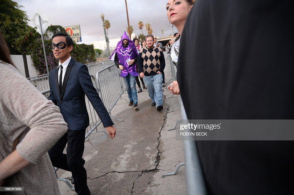 Fans arrive in costume for an impromptu concert by the indie rock band Arcade Fire, outside the iconic Capitol Records building in Hollywood, California October 29, 2013. Arcade Fire staged the event to mark the release of their new album Reflektor.'