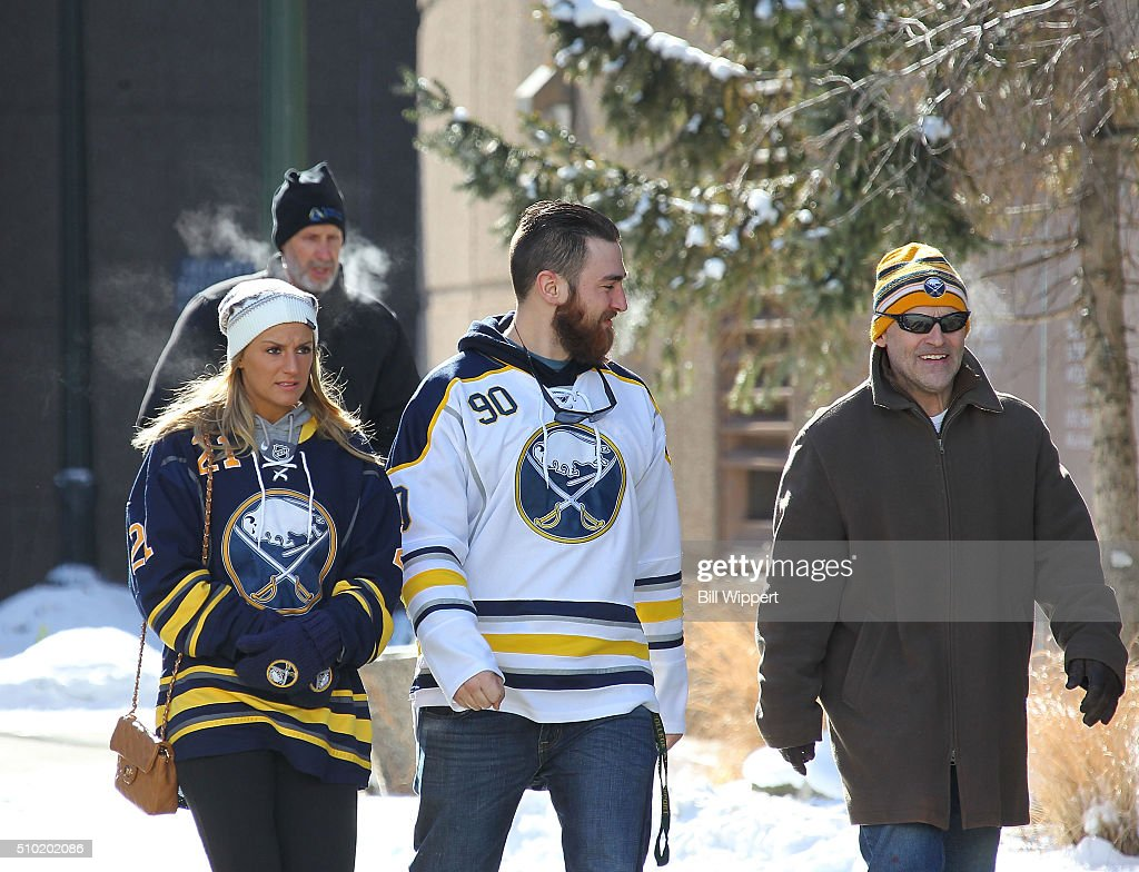 Fans arrive on a near-zero temperature day to watch the Buffalo Sabres play the Colorado Avalanche in an NHL game on February 14, 2016 at the First Niagara Center in Buffalo, New York.