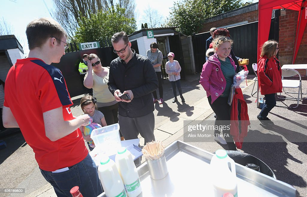 Fans arrive prior to the WSL match between Arsenal Ladies and Birmingham City Ladies at Meadow Park on May 1, 2016 in Borehamwood, England.