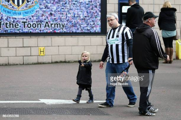 Fans arrive to the stadium prior to the Premier League match between Newcastle United and Crystal Palace at St James Park on October 21 2017 in...