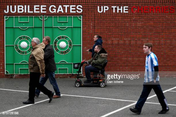 Fans arrive to the stadium prior to the Premier League match between AFC Bournemouth and Huddersfield Town at Vitality Stadium on November 18 2017 in...
