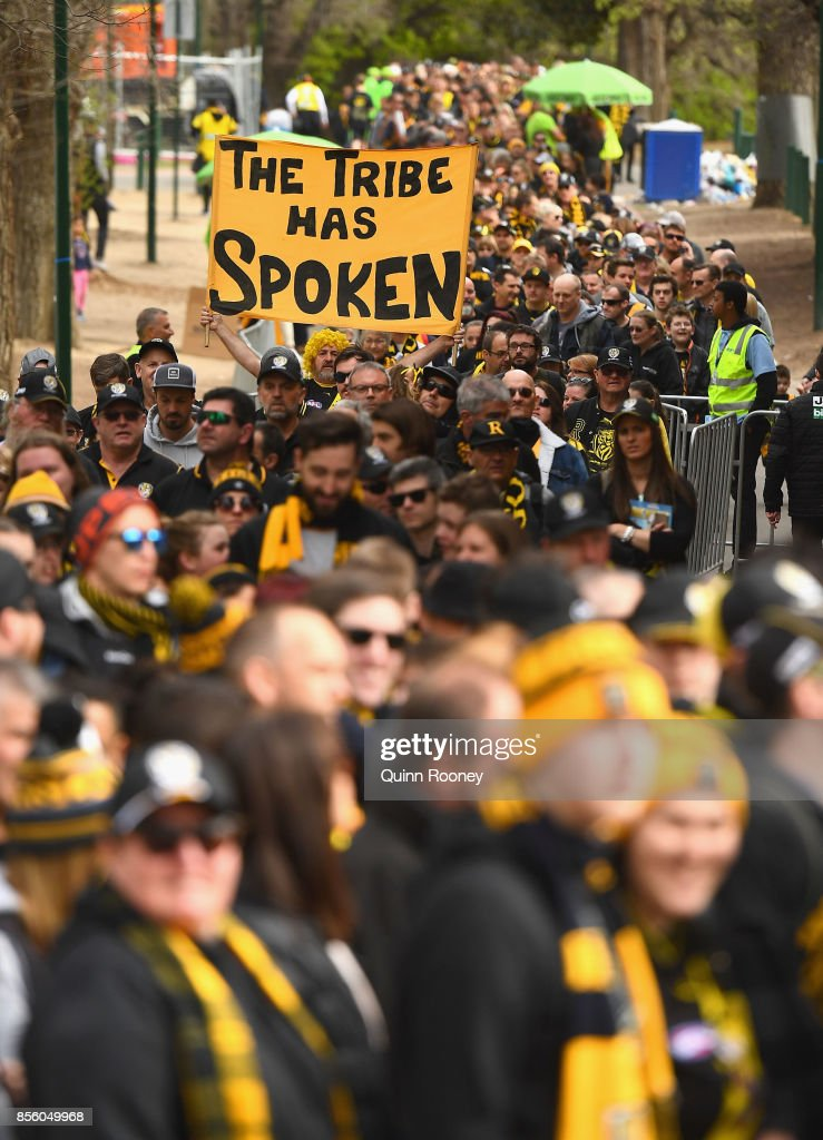 Fans arrive to watch the Tigers players celebrate winning yesterday's AFL Grand Final, at Punt Road Oval on October 1, 2017 in Melbourne, Australia.