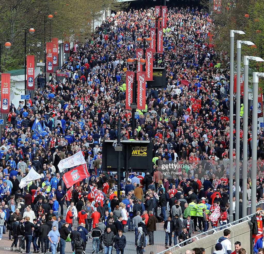 Fans arriving at Wembley Stadium before the FA Cup semi-final sponsored by Budweiser between Liverpool and Everton at Wembley Stadium on April 14, 2012 in London, England.