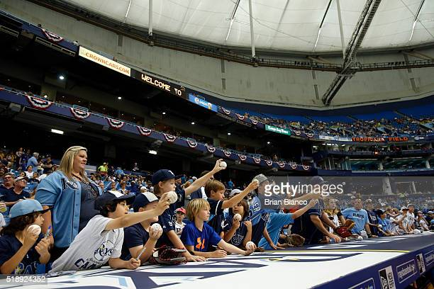 Fans ask for autographs before the start of the Tampa Bay Rays' Opening Day game against the Toronto Blue Jays on April 3 2016 at Tropicana Field in...