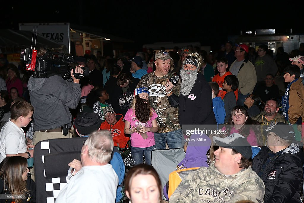 Fans ask questions to the cast of Duck Dynasty at the unveiling of 'Big Hoss' the largest HD video board in the world at Texas Motor Speedway on March 19, 2014 in Fort Worth, Texas.