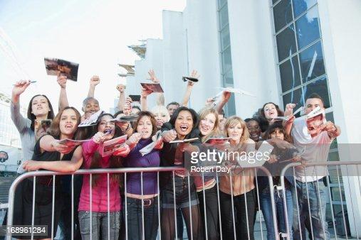 Fans asking for autographs behind barrier