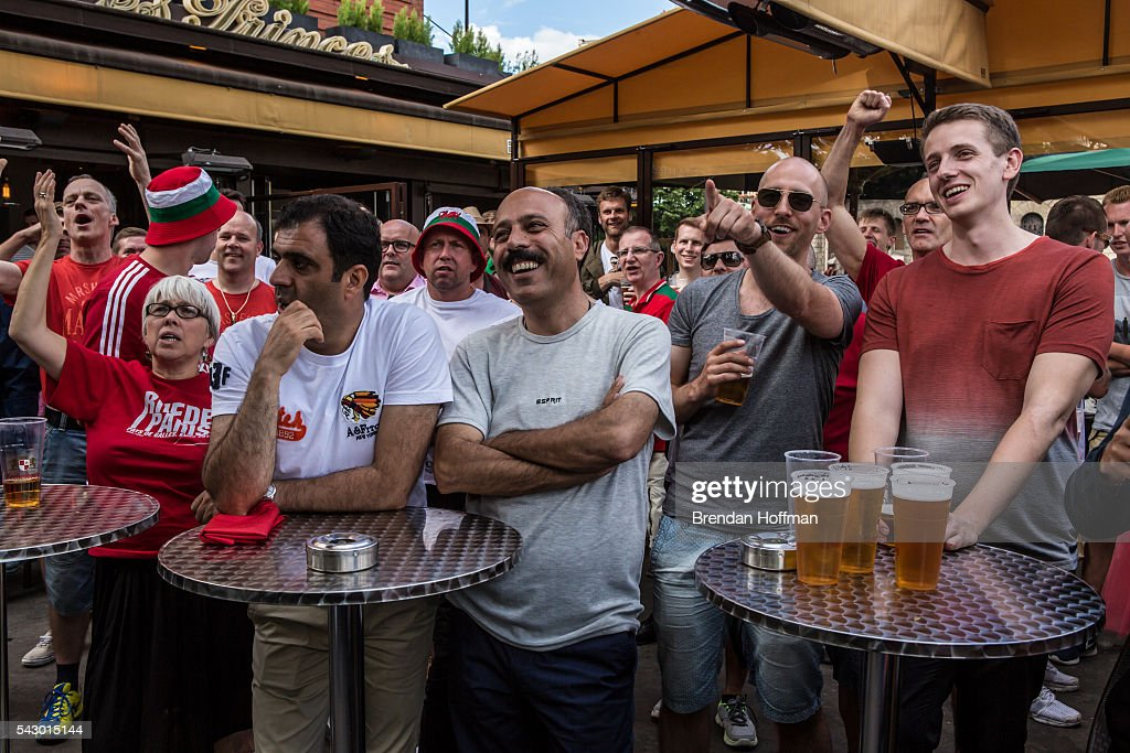 Fans at a bar near the Parc des Princes stadium watch a television broadcast of the football match between Wales and Northern Ireland during UEFA Euro 2016 tournament on June 25, 2016 in Paris, France. The two teams met in the Round of 16 at Parc des Princes in Paris, where Wales won 1-0.
