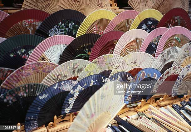 Fans at a market stall