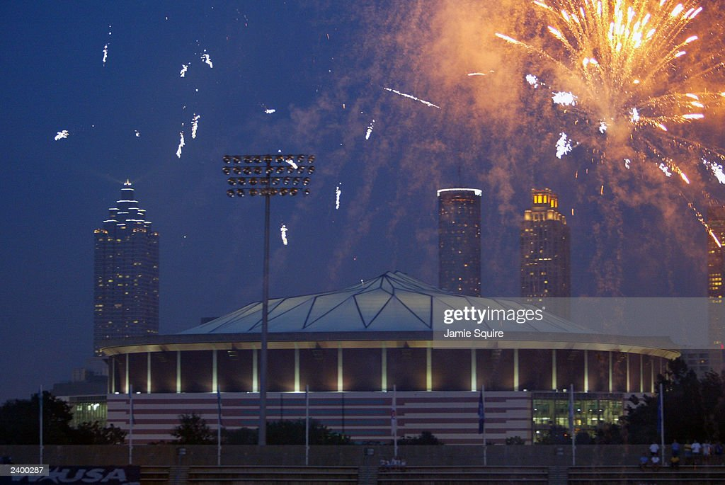 Fans at Herndon Stadium watch fireworks explode over the Georgia Dome following the game between the New York Power and the Atlanta Beat on August 10...