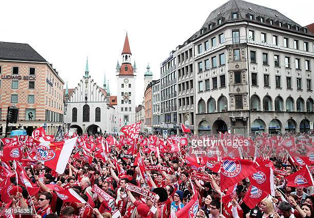 Fans at Marienplatz wait for Bayern Muenchen to present the trophy after winning the DFB Cup Final match on May 18 2014 in Munich Germany