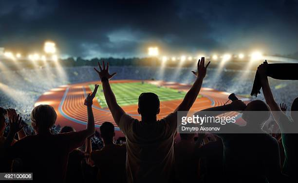 Fans at olympic stadium with running tracks