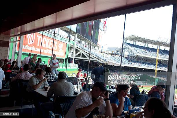 Fans at the Taste of the Majors restaurant get a nice view of the field at Nationals Park before the exhibition game against the Boston Red Sox on...