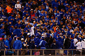 Fans attempt to catch a foul ball during Game One of the 2015 World Series at Kauffman Stadium on October 27 2015 in Kansas City Missouri