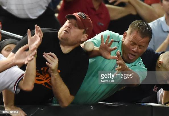Fans attempt to catch a foul ball during the second inning of a game between the Arizona Diamondbacks and the St Louis Cardinals at Chase Field on...