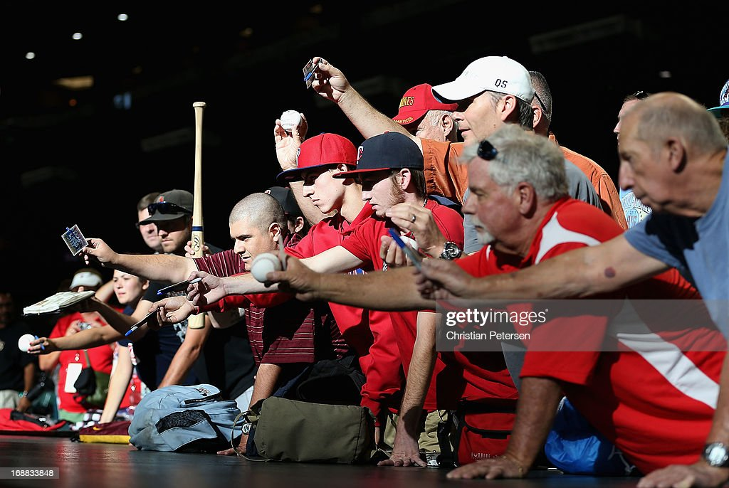 Fans attempt to get autographs before the MLB game between the Arizona Diamondbacks and the Philadelphia Phillies at Chase Field on May 10, 2013 in Phoenix, Arizona. The Diamondbacks defeated the Phillies 3-2.