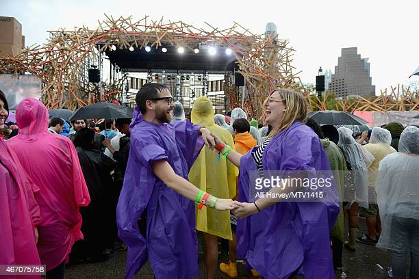Fans attend 2015 MTV Woodies Festival in the rain on March 20 2015 in Austin Texas