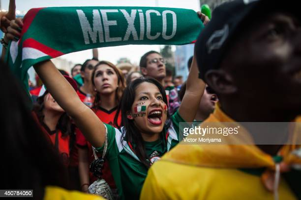 Fans attend a viewing of the 2014 FIFA World Cup match between Mexico and Brazil at the FIFA Fan Fest Arena on June 17 2014 in Sao Paulo Brazil...