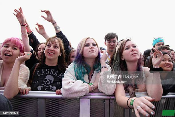Fans attend the band Girls performance during Day 1 of the 2012 Coachella Valley Music Arts Festival held at the Empire Polo Club on April 13 2012 in...