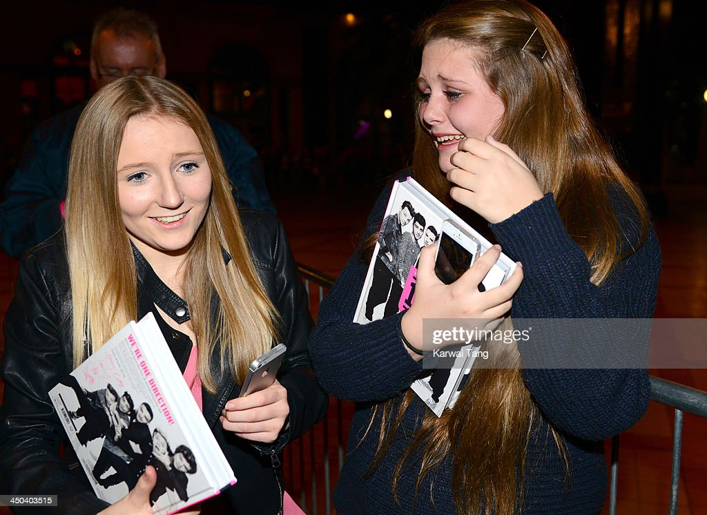 Fans attend the book signing of One Direction's new book 'Where We Are' held at Alexandra Palace on November 18, 2013 in London, England.
