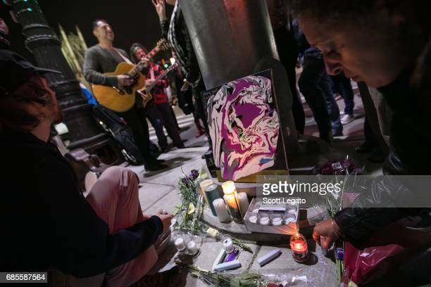 Fans attend the candlelight vigil to mourn the death of singer Chris Cornell at the Fox Theatre the venue where Chris Cornell performed his final...