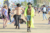 Fans attend the Coachella Valley Music and Arts Festival at The Empire Polo Club on April 19 2015 in Indio California