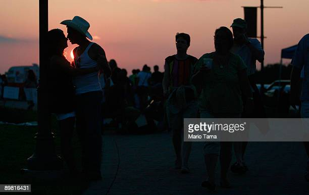 Fans attend the concert marking the 40th anniversary of the Woodstock music festival August 15 2009 in Bethel New York On August 1517 in 1969 an...