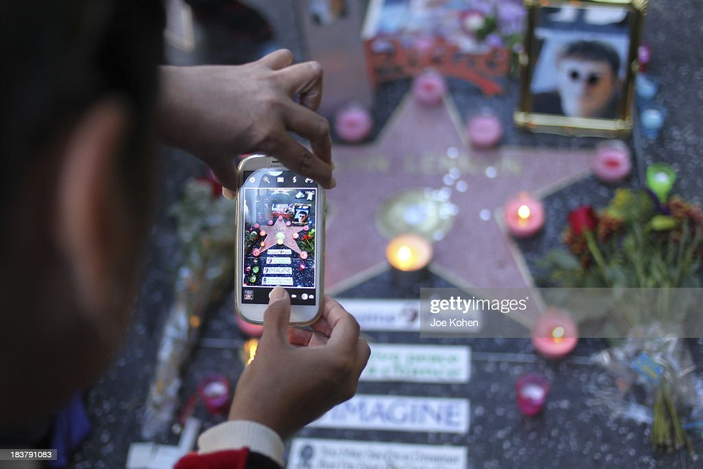 Fans attend the John Lennon public birthday celebration at his Hollywood Walk of Fame Star on October 9, 2013 in Hollywood, California.