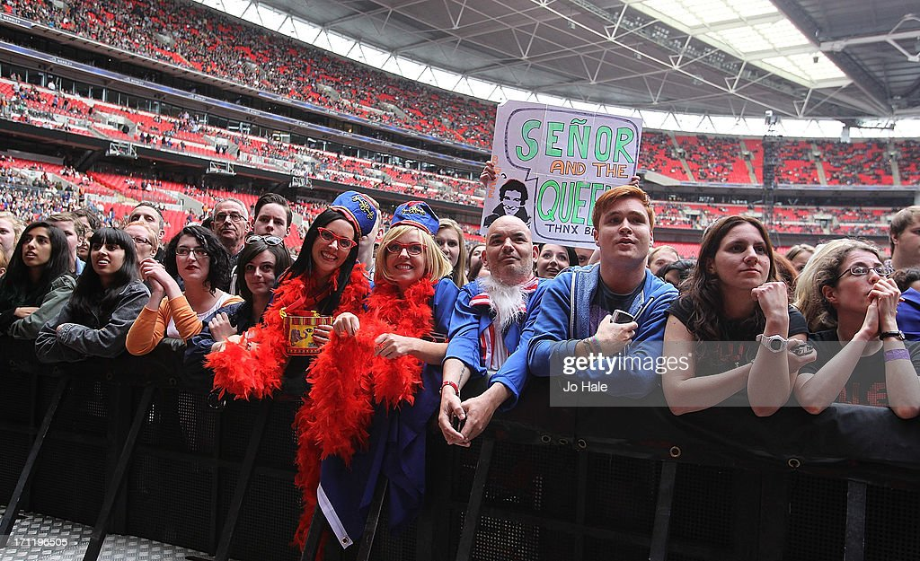 Fans attend The Killers performance on stage at Wembley Stadium on June 22, 2013 in London, England.